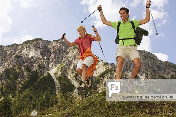Austria  Salzburger Land  couple cutting a caper