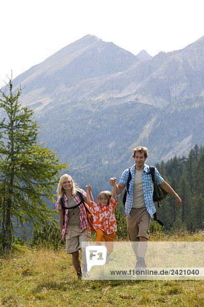 Austria  Salzburger Land  couple with son (8-9) hiking