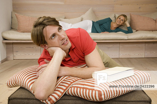 Young couple relaxing in living room  portrait