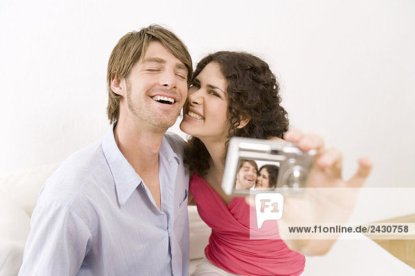 Couple Taking picture with digital camera  close-up