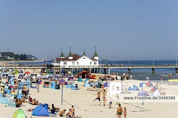Tourists on beach with pier in background  Ahlbeck  Usedom  Mecklenburg-West Pomerania  Germany
