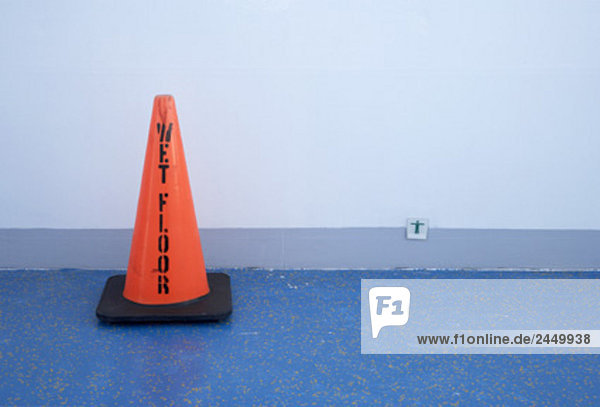 still life of cone warning of wet floor on cruise ship