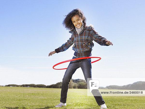 Young Girl playing mit Hula hoop