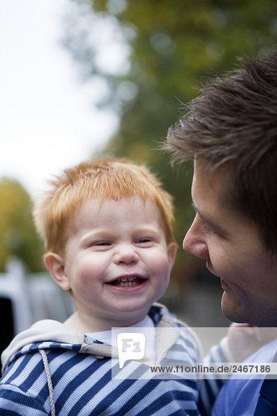Smiling father with son Sweden.