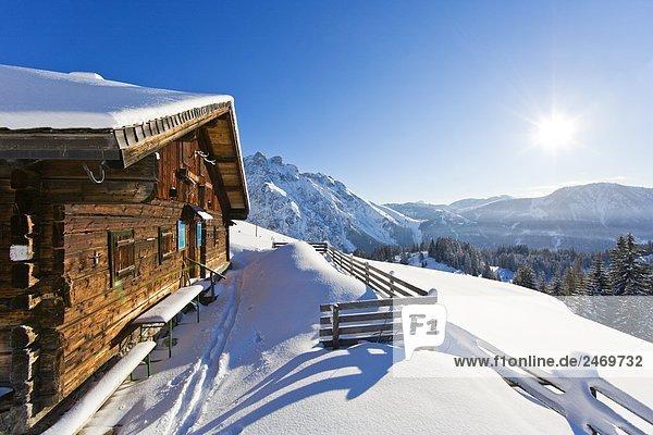 Snowcovered fence in front of mountain cabin  Elmaualm  Tennengebirge  Salzachtal  Hagengebirge  Salzburger Land  Austria