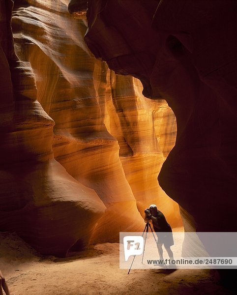 Photographer shooting the Water-carved Slot Canyon  Antelope Canyon near Page  Arizona  USA