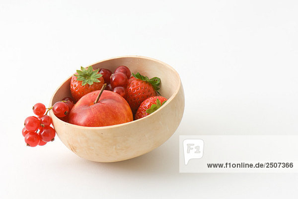Variety of fruit in a wooden bowl