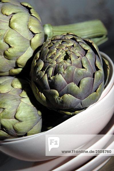 Artichokes in bowl  close-up