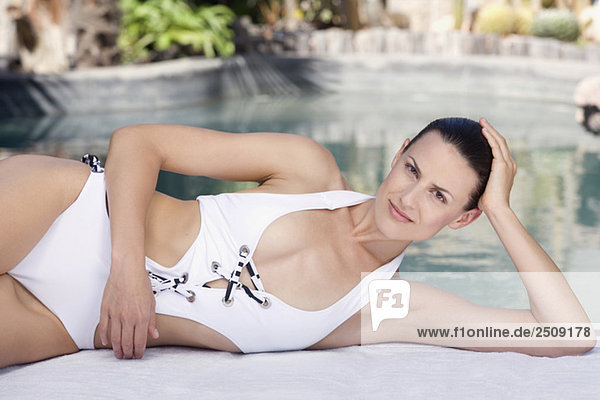 Young woman relaxing on pool side  portrait