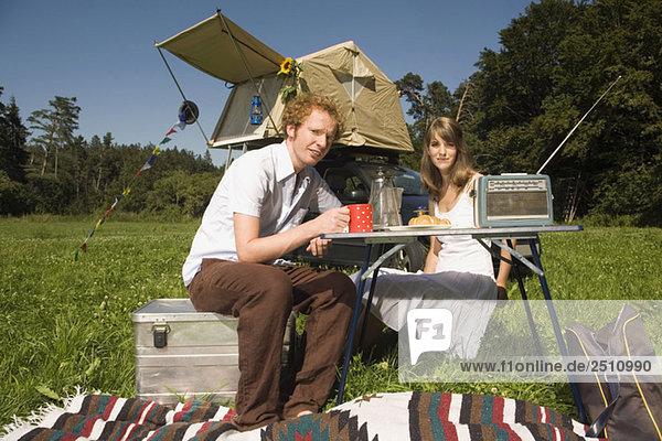 Germany  Bavaria  Young couple having breakfast