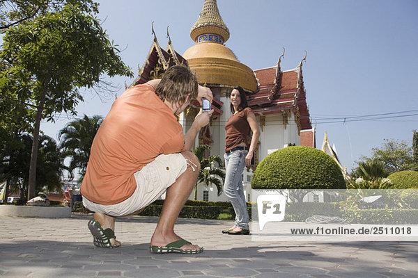 Asia  Thailand  Tourist couple with camera
