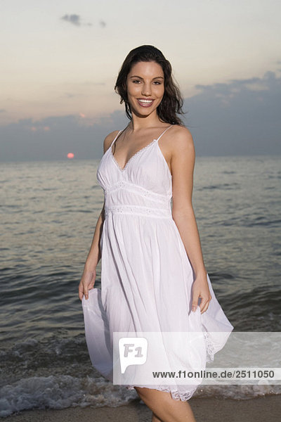 Asia  Thailand  Young woman on beach  smiling  portrait