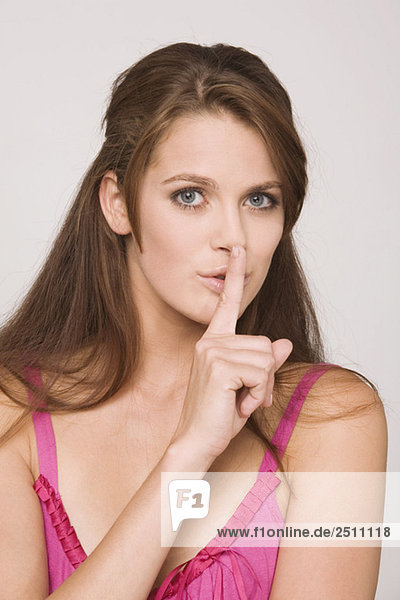 Young woman  finger to mouth  portrait
