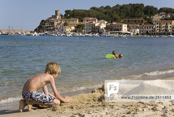 Italy  Elba  Marina di Campo  boy playing on beach