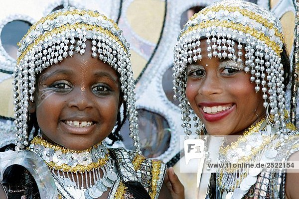 Two kids at the kids parade with Carnival costumes at the Trinidad Carnival  Queens Park Savannah  Port of Spain  Island of Trinidad  Republic of Trinidad and Tobago