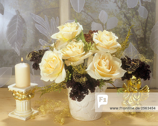Christmas arrangement with yellow roses