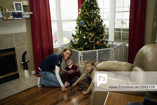 family with Christmas tree in home