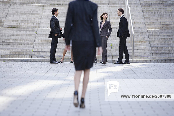 Businesswoman walking  businesspeople in the foreground
