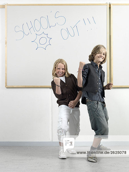 Two boys by the whiteboard