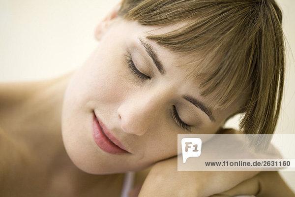 Woman resting head on shoulder  eyes closed