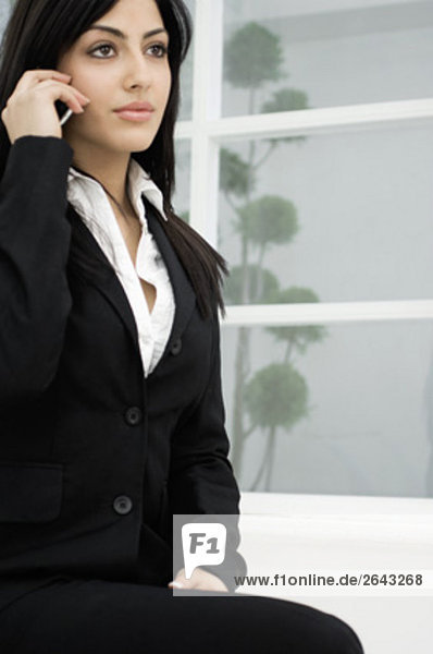 portrait of young businesswoman talking on mobile phone