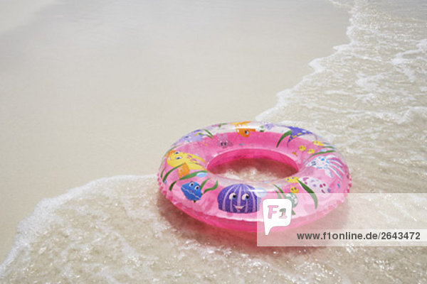 floating tyre on sandy beach