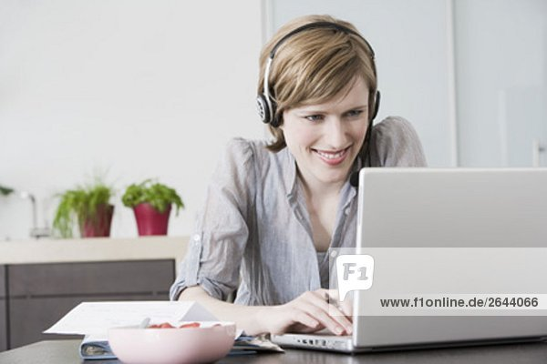 portrait of woman working at home with laptop computer
