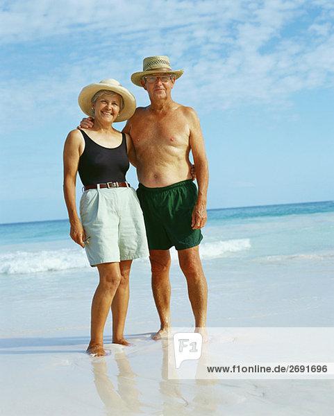 Senior couple standing on the beach and posing  Bermuda