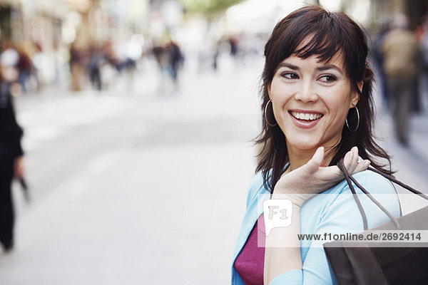 Close-up of a mid adult woman holding a shopping bag