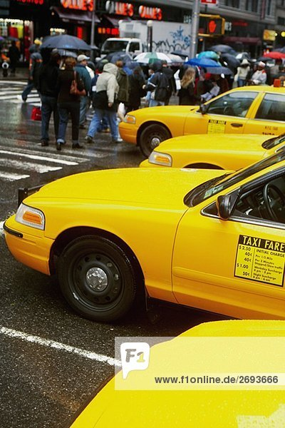 Yellow taxi waiting at the zebra crossing
