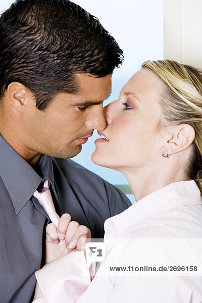 Close-up of a businessman kissing a businesswoman