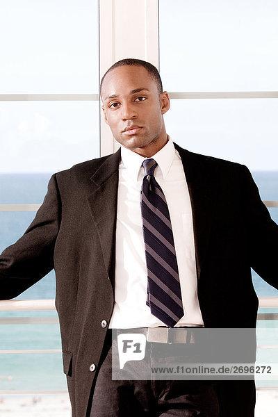 Portrait of a businessman leaning against a railing