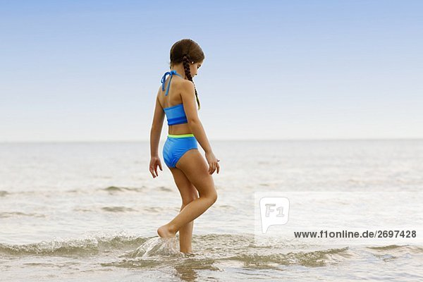 Side profile of a girl walking on the beach