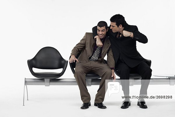 Two businessmen having a playful fight