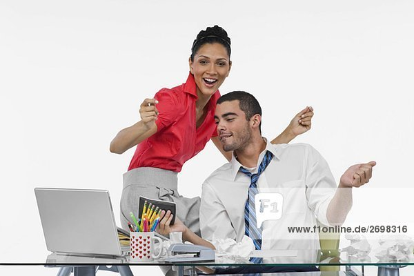 Businesswoman and a businessman dancing together in an office