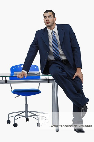 Businessman sitting at a desk and thinking