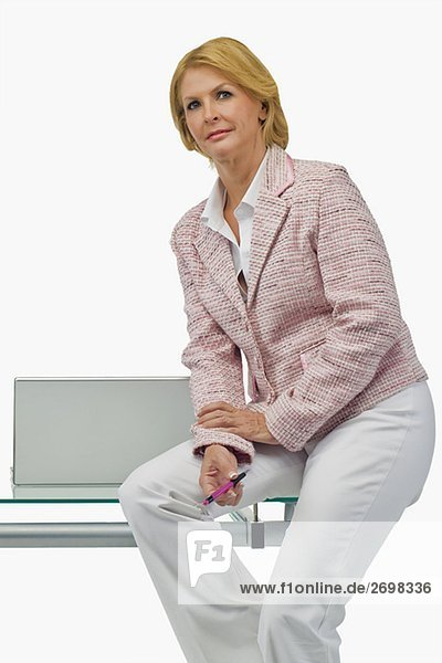 Portrait of a businesswoman sitting on a table