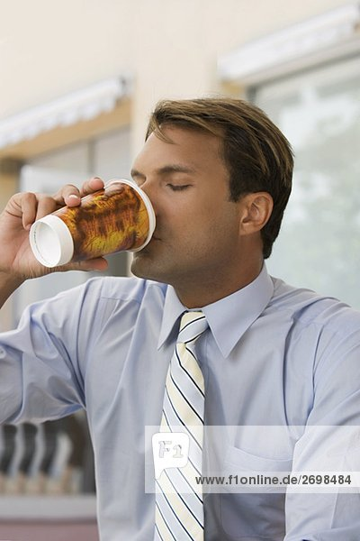 Close-up of a businessman drinking coffee