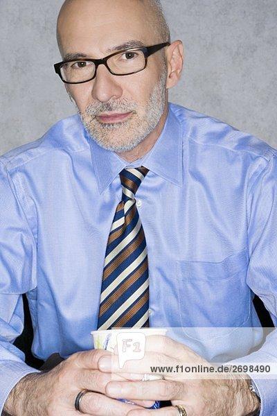 Portrait of a businessman holding a glass