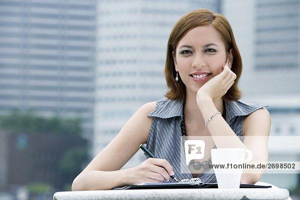 Portrait of a businesswoman sitting at a sidewalk cafe