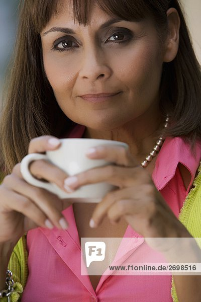 Portrait of a mature woman holding a cup of coffee