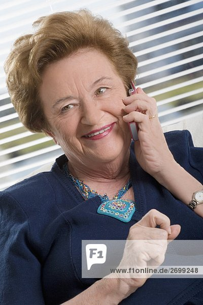 Close-up of a senior woman talking on a mobile phone and smiling