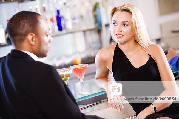 Young couple sitting at a bar counter