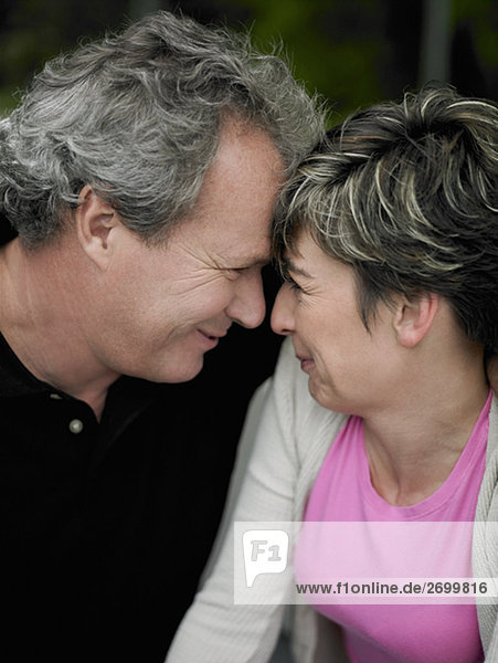 Close-up of a mature couple face to face and smiling
