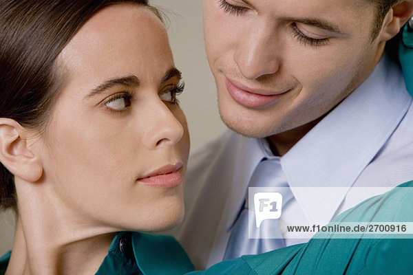 Close-up of a businessman and businesswoman looking at each other