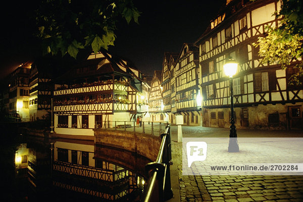 Street lights illuminated during night in Old Town  Strasbourg  France