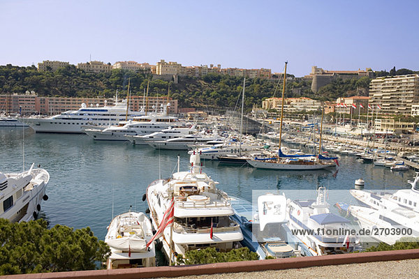 Ferries and boats docked at a harbor  Port of Fontvieille  Monte Carlo  Monaco