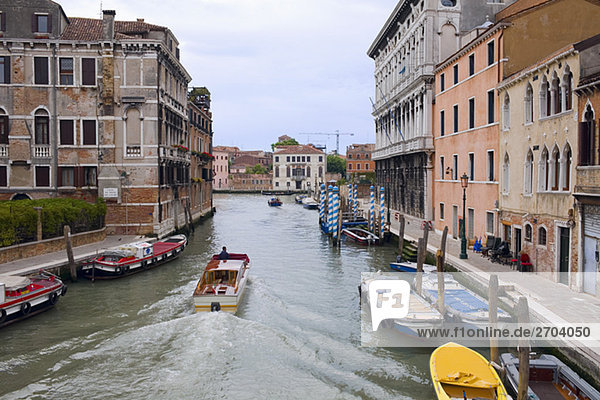 Boats in a canal  Venice  Italy