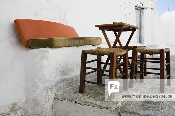 Empty table with stools, Mykonos, Cyclades Islands, Greece