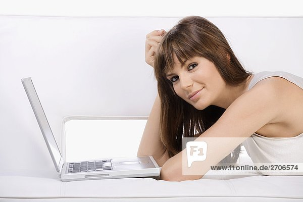 Portrait of a young woman using a laptop